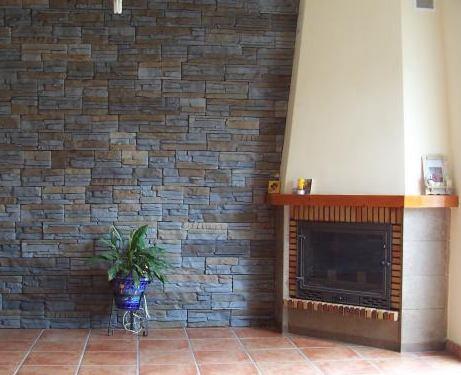 Revestimiento de piedra en paredes naturales y for Piedra revestimiento pared